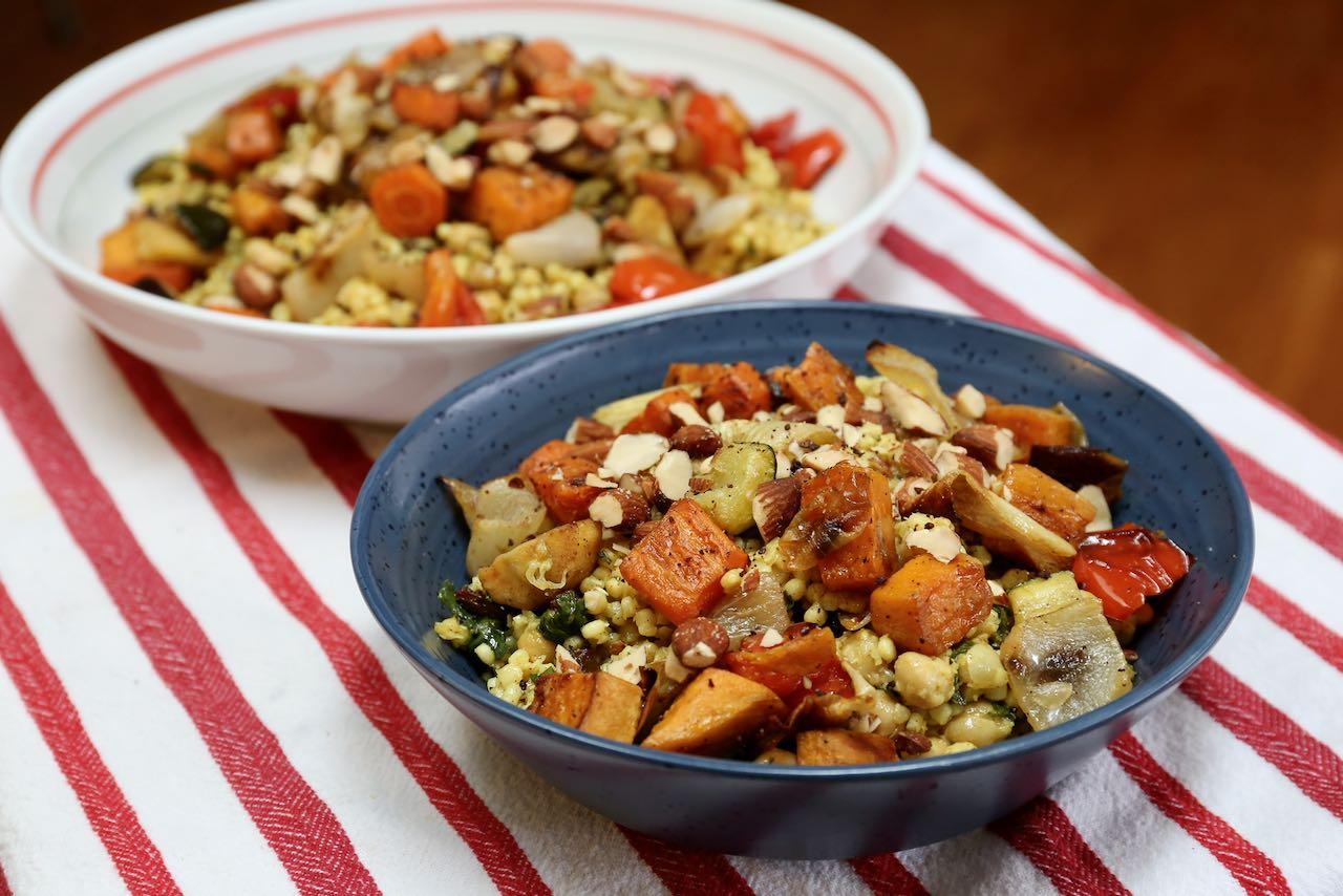 Serve Roasted Vegetable Couscous topped with chopped almonds.