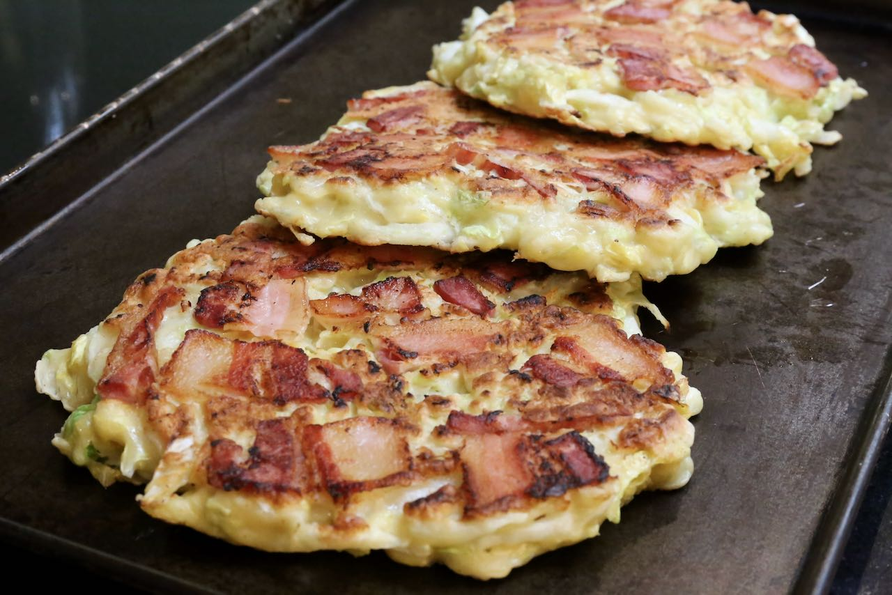 Let Japanese Cabbage Pancakes rest on a baking sheet until ready to serve.