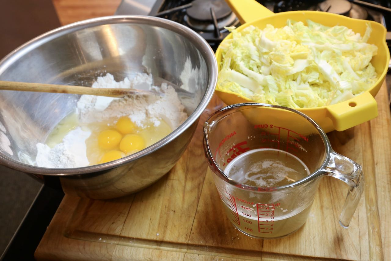 Osaka Okonomayaki is prepared with flour, eggs, daishi and shredded cabbage.