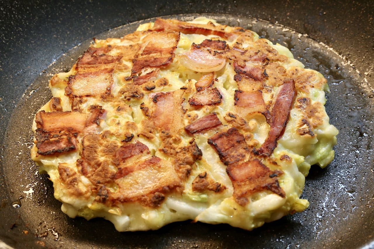 Crispy pork pieces cook into the Japanese Cabbage Pancake.