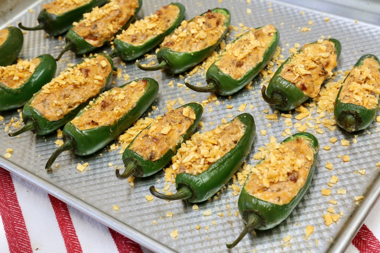 Bake Keto Jalapeno Poppers until bubbling and top with smoky hickory sticks.