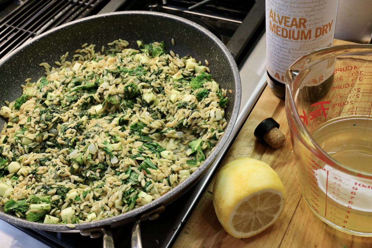 Cook orzo mixture with lemon juice, sherry and chicken stock.