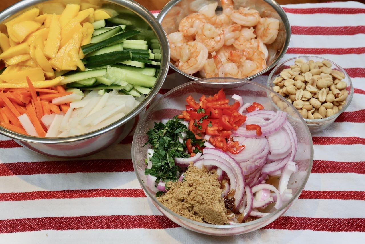 Prepare Vietnamese Mango Salad ingredients in separate mixing bowls.