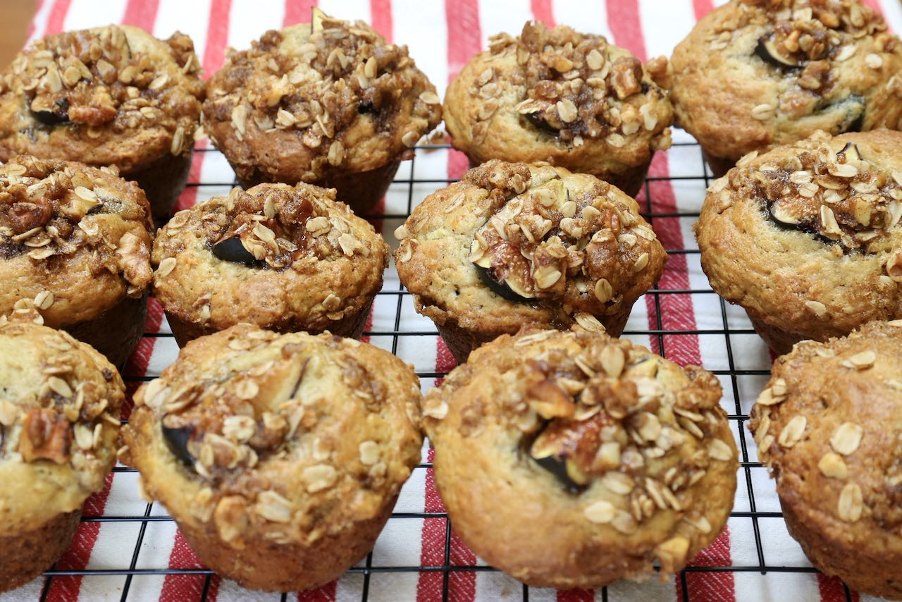 Cool fig muffins on a rack before serving.