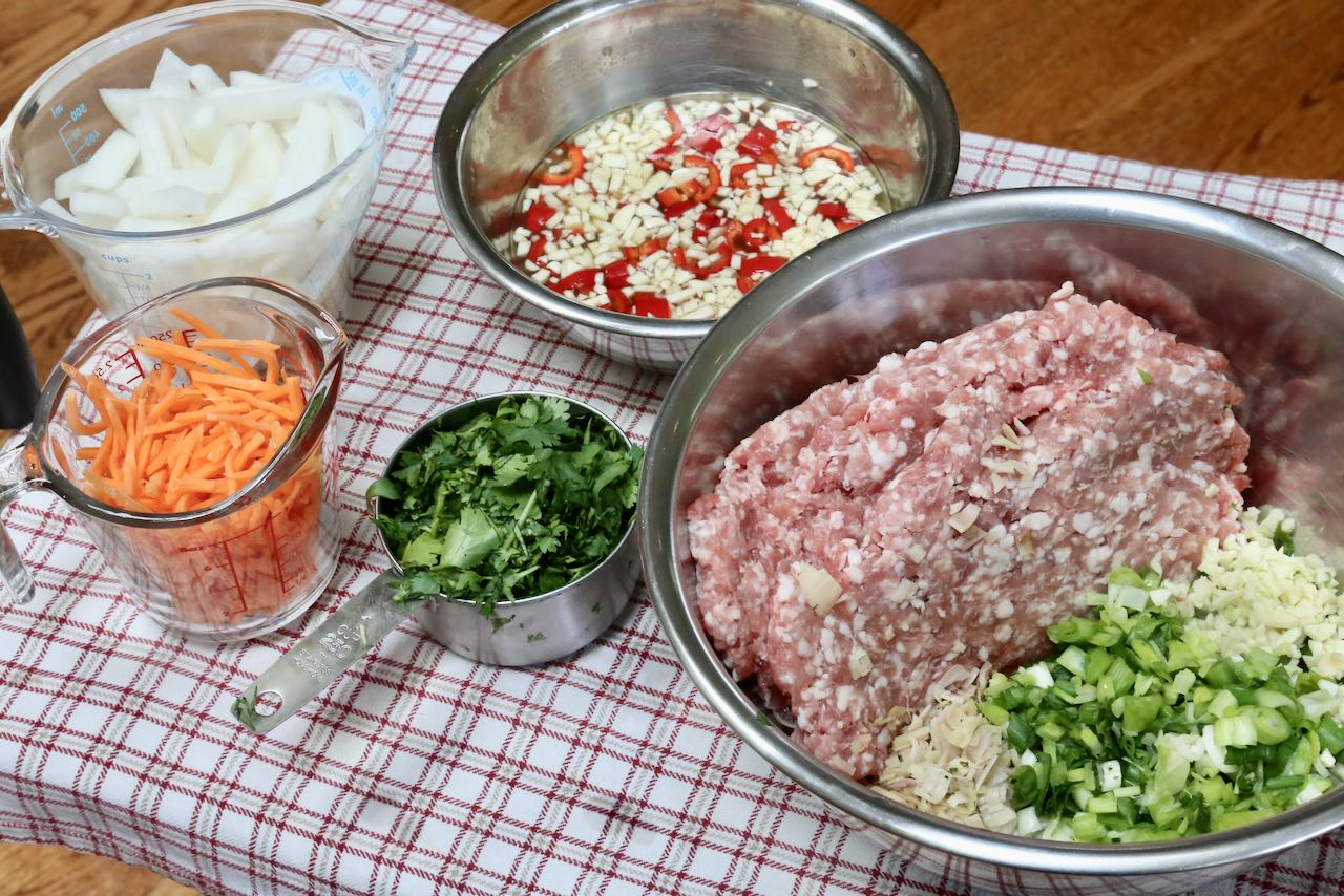 Combine pork meatball ingredients in a large bowl and whisk together nuac cham dressing.