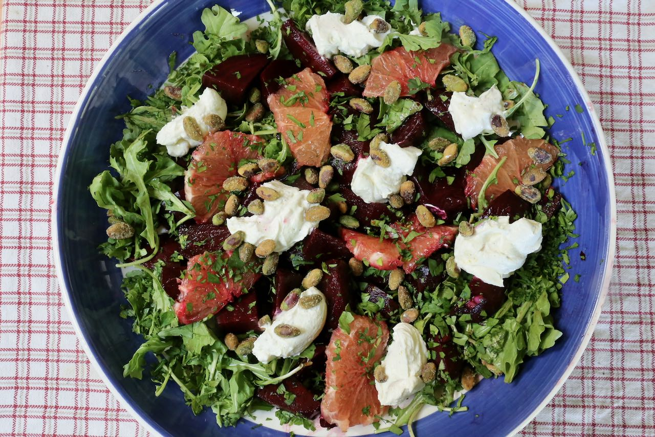 Serve Roasted Beet Salad family style topped with chopped herbs and pistachio.
