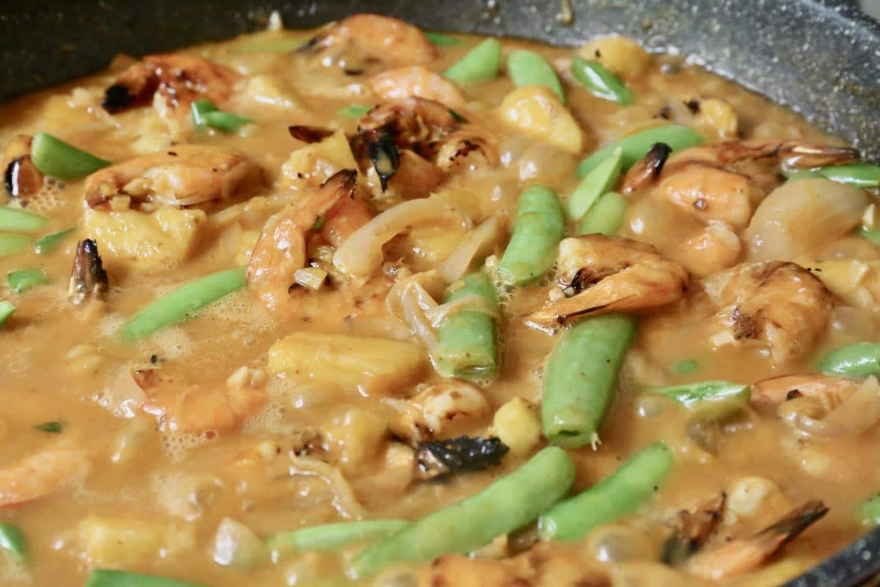 Simmer the Thai Prawn Curry until well combined and the sauce has thickened to your liking.