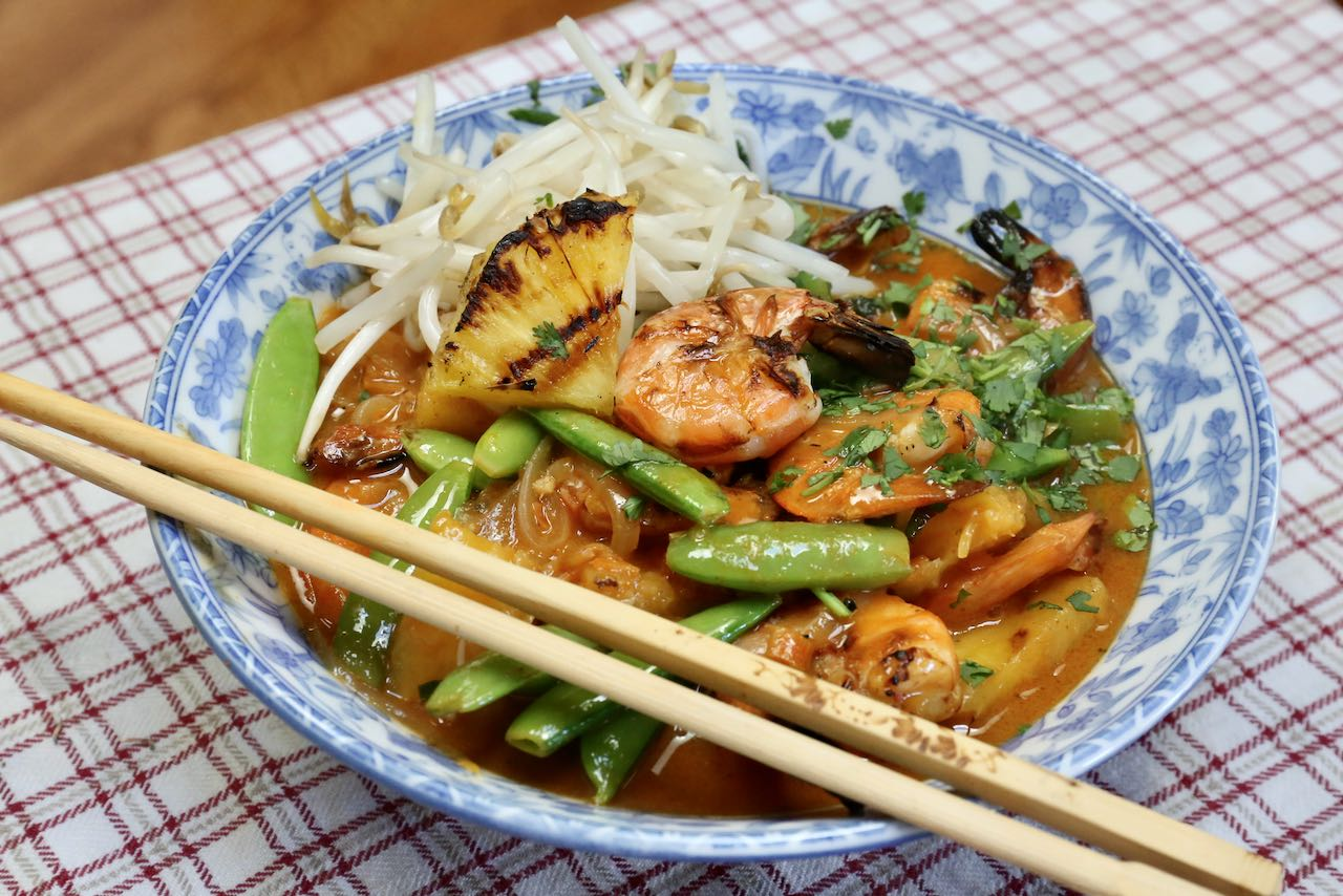 Thai Red Prawn Curry is an excellent meal idea for one served in a bowl with chopsticks.