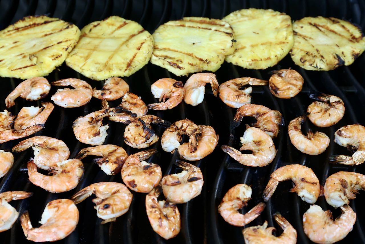 Barbecue fresh pineapple and prawns to enjoy smoky shrimp and caramelized tropical fruit flavours.