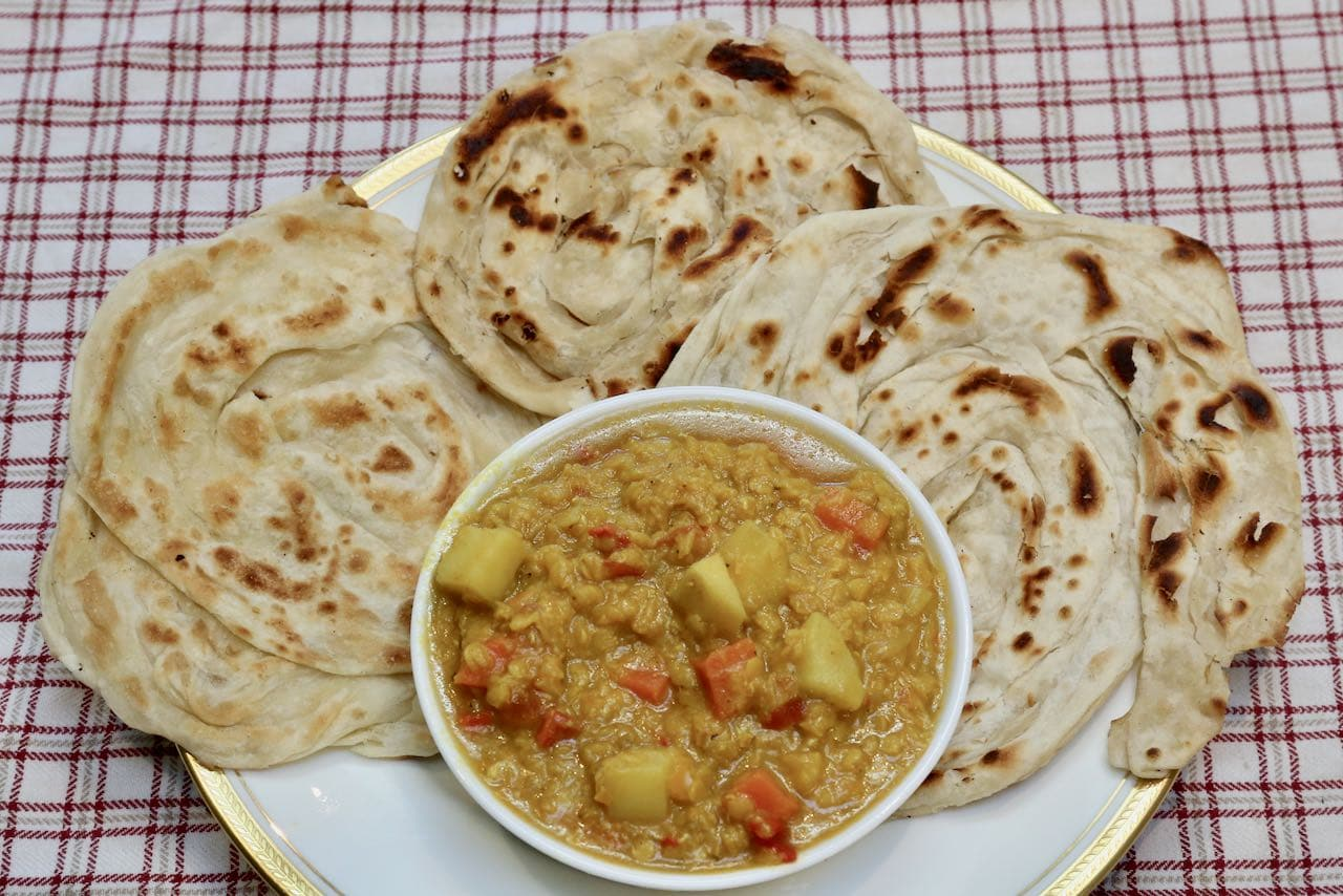 The best way to eat our roti canai curry recipe is with your hands.