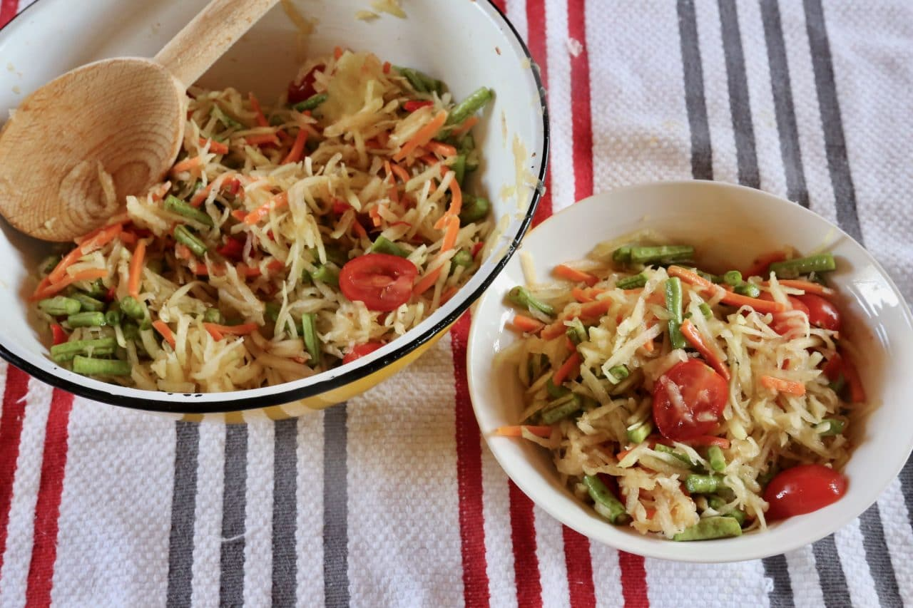 Serve Laos Papaya Salad in a large bowl at the table family-style or in small salad bowls.