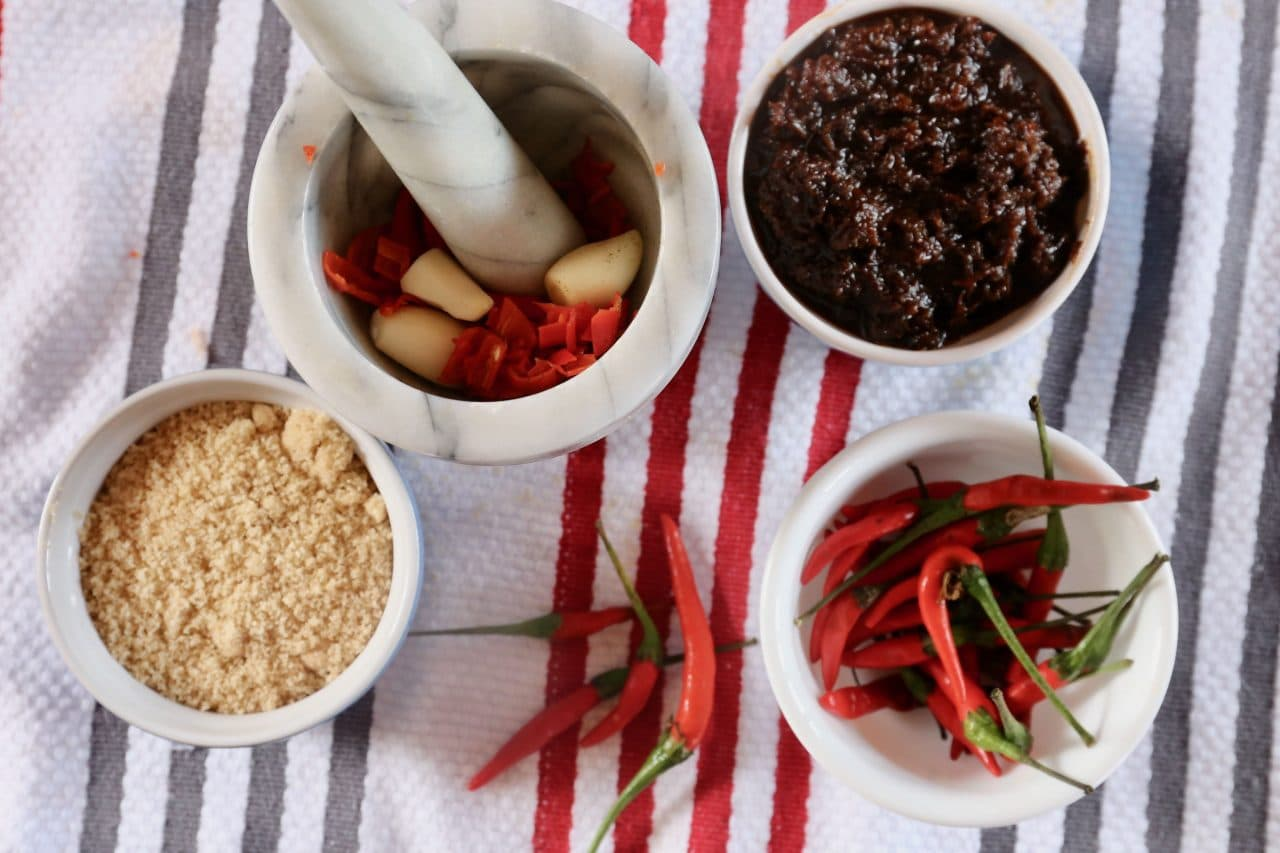 Traditionally Laos Papaya Salad dressing is made in a mortar and pestle.