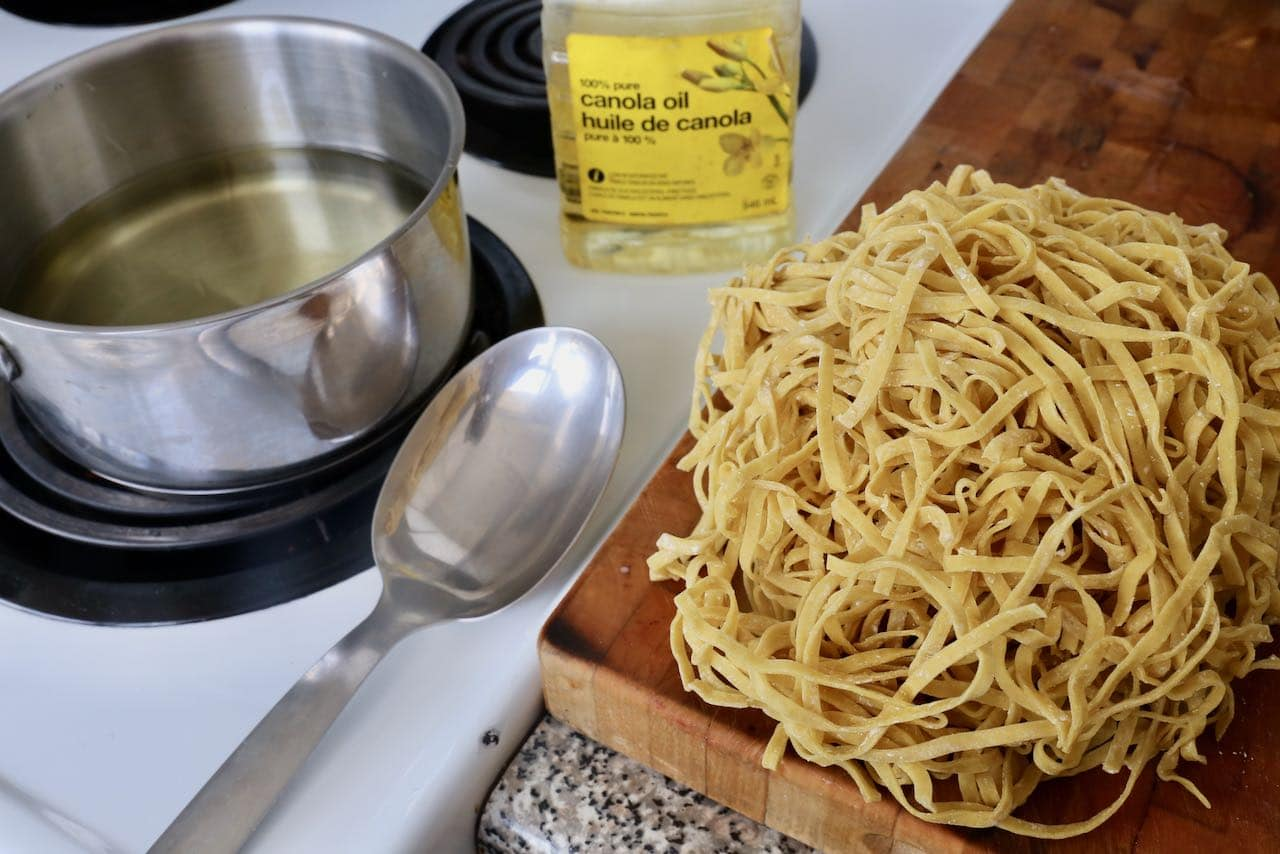 Deep fry fresh Chinese egg noodles for Khao Soi's distinctive crunchy topping.