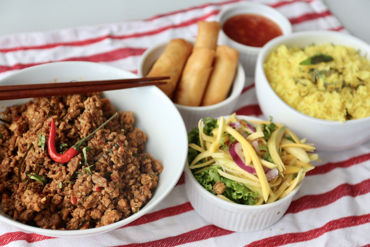 Serve dry Thai beef & pork mince curry with mango salad, spring rolls and jasmine rice.