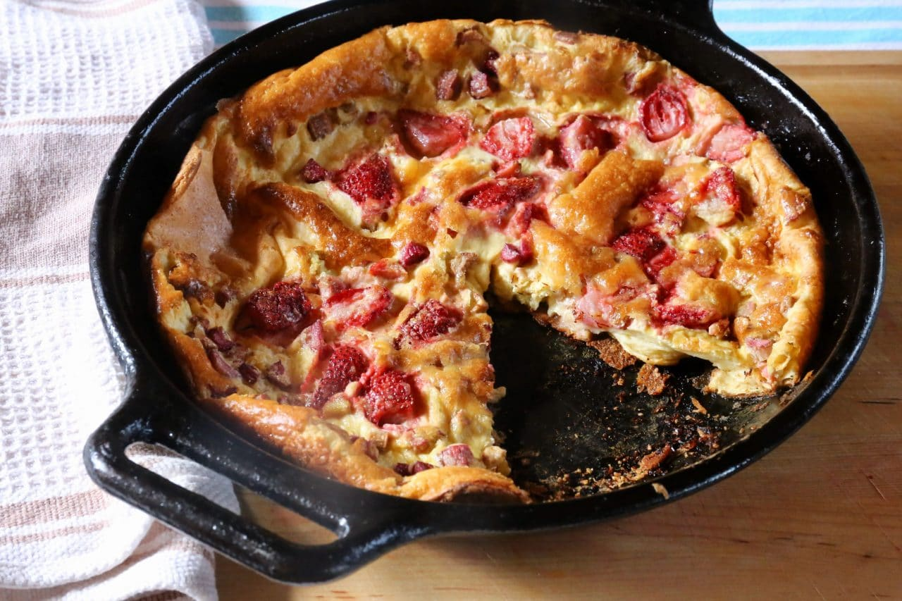 Use a sharp knife and pie server to plate each slice of the homemade German Pancake.