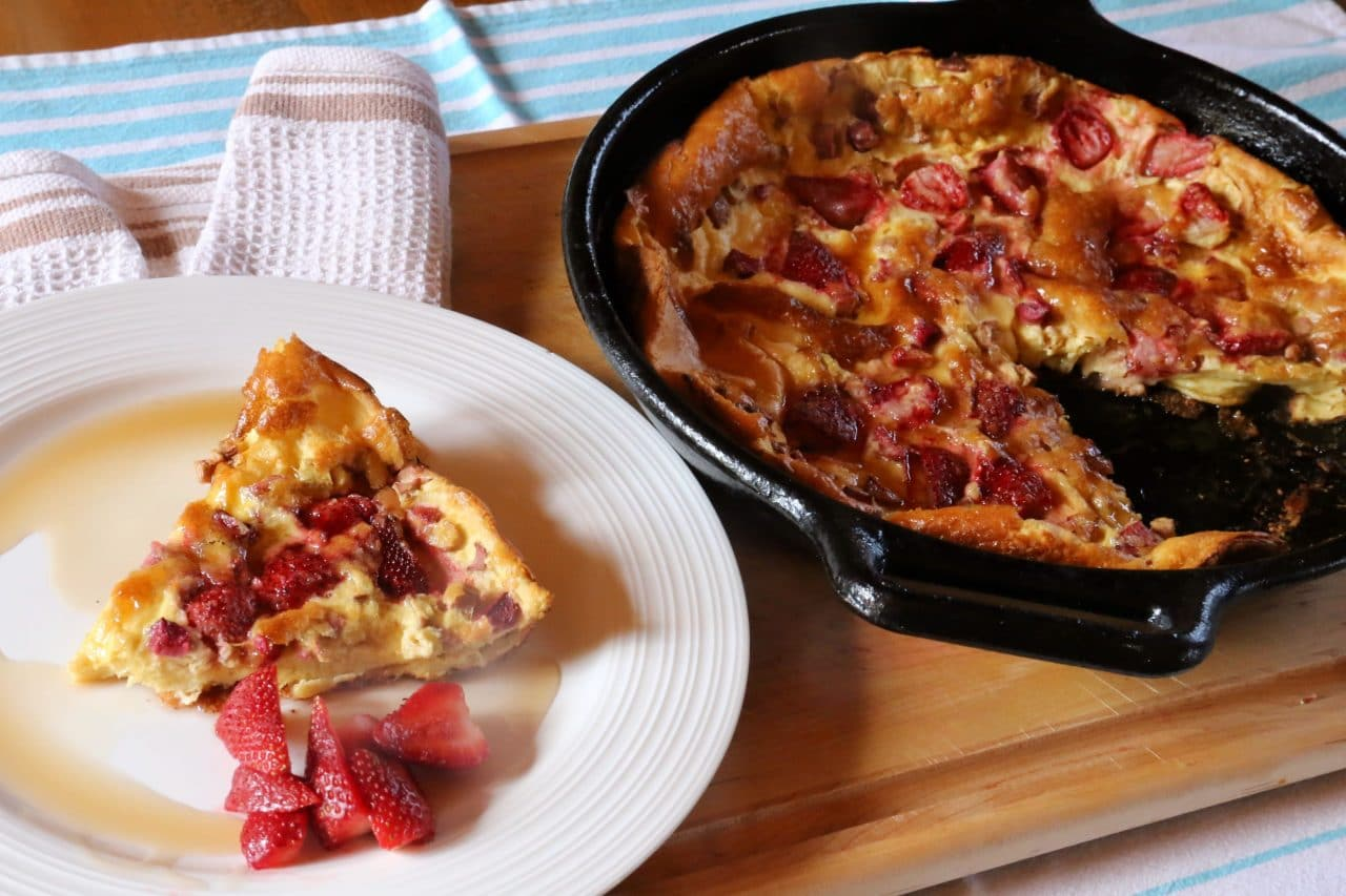 Serve our Strawberry Dutch Baby with sliced berries, maple syrup and ice cream for dessert.