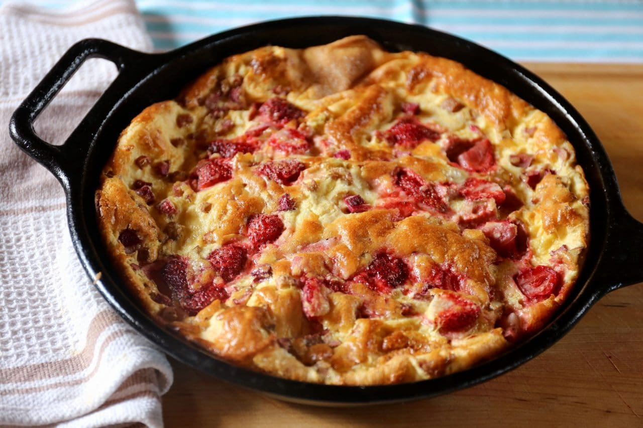 The best Strawberry Dutch Baby features a light interior and crunchy browned exterior.