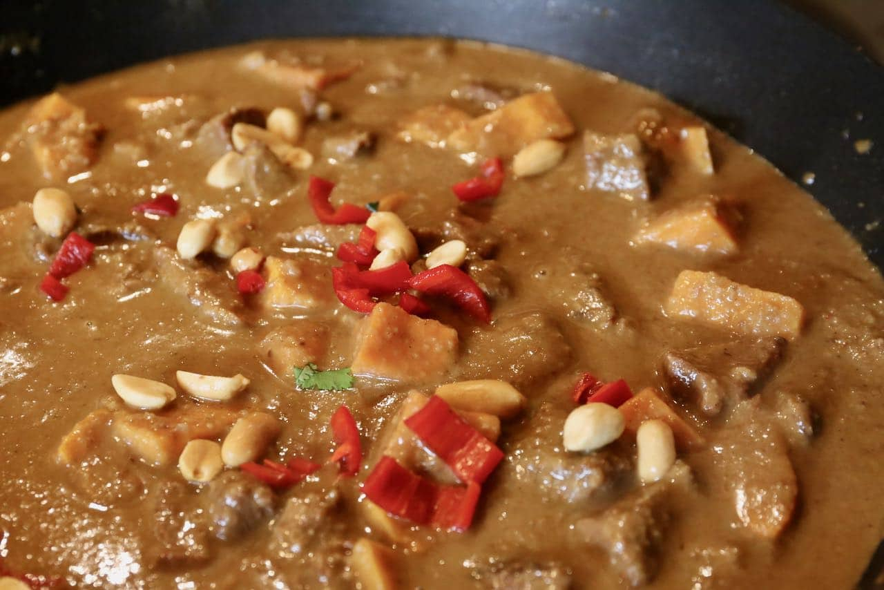 Add spicy Thai red chili and peanuts to  Gaeng Masaman beef and sweet potato stew.