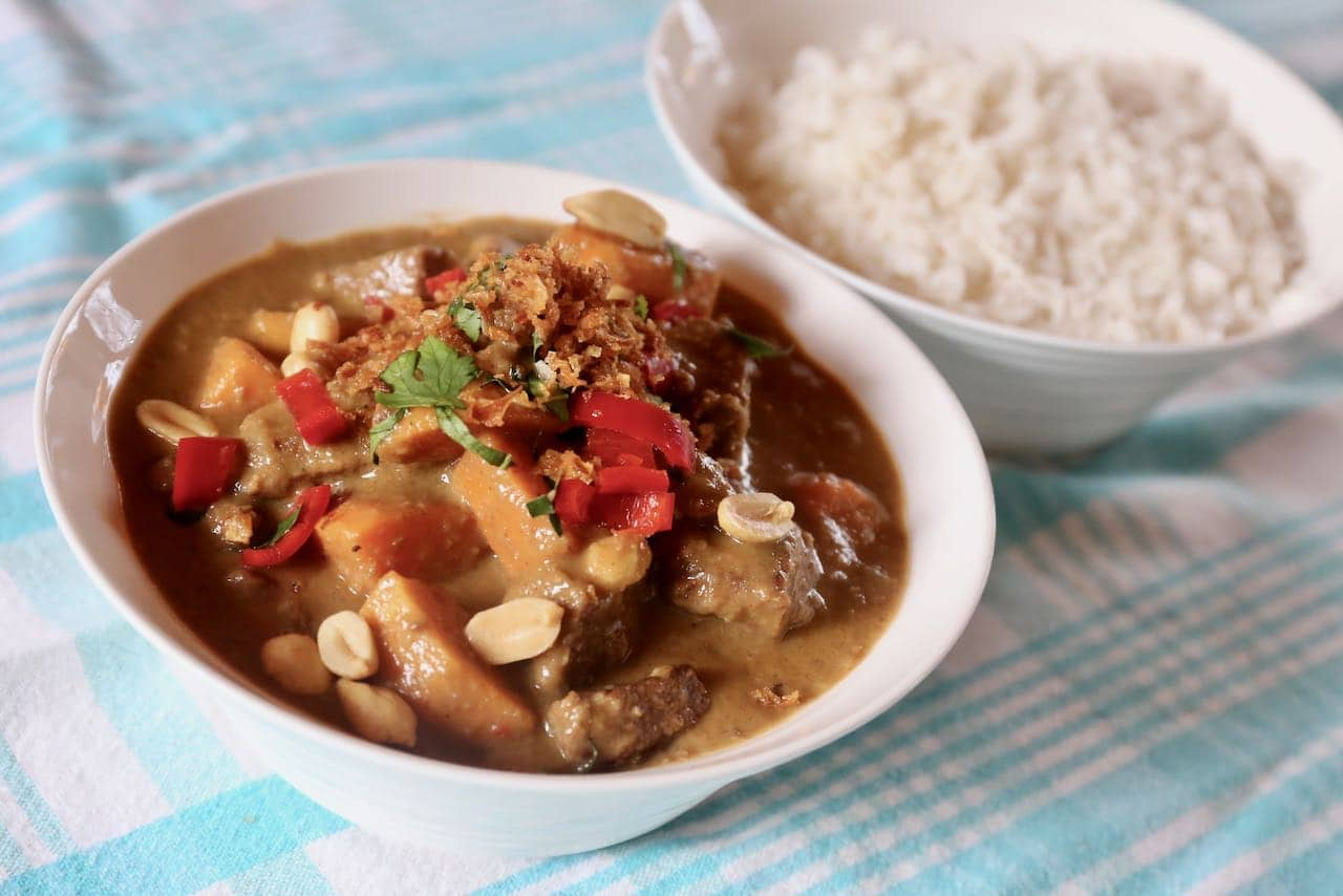 Serve Gaeng Masaman topped with peanuts, red chili, cilantro and crispy fried onions.