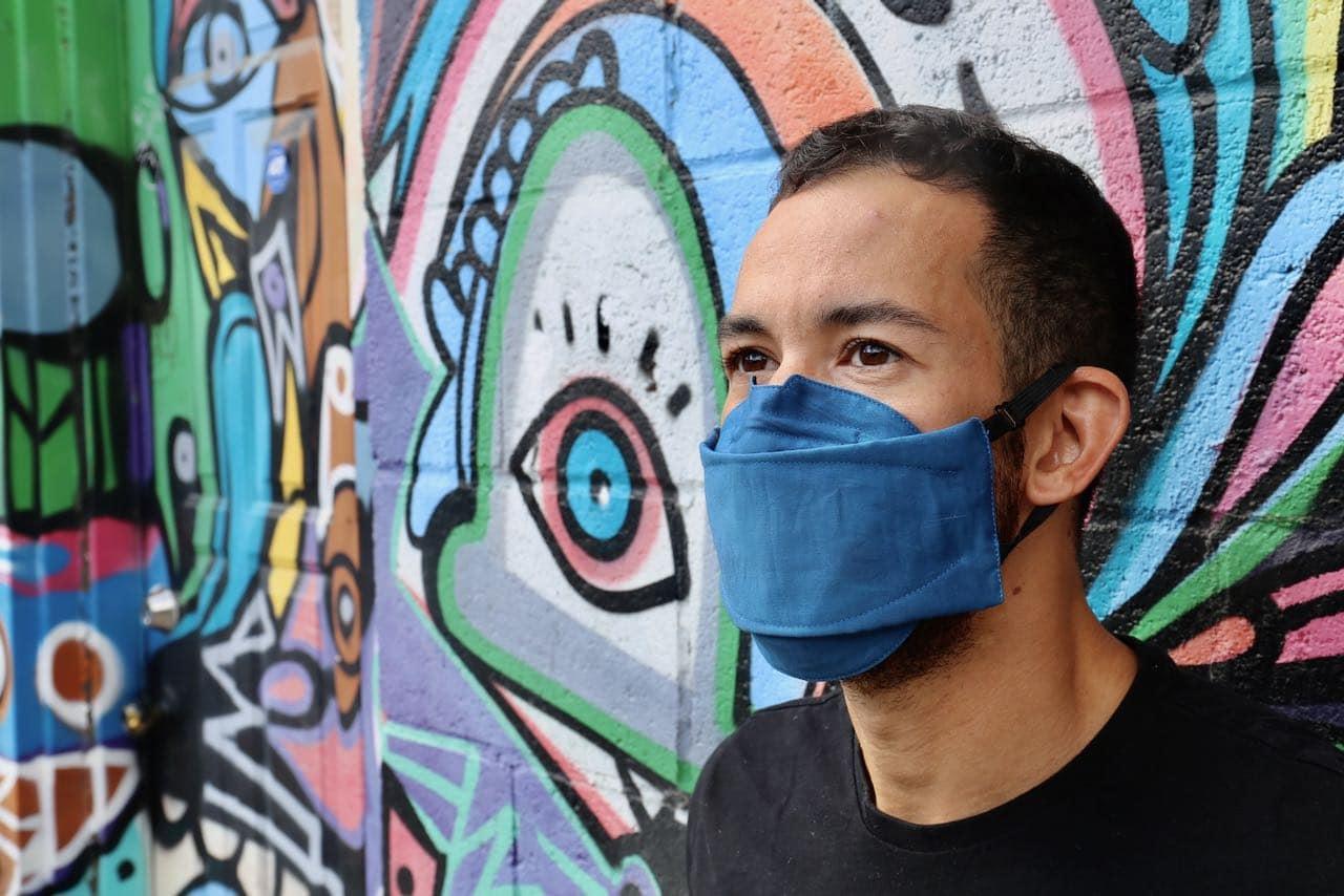 """Bryan wearing """"Full Metal Blue Light"""" stylish mask."""