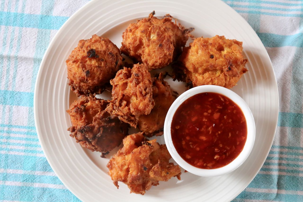 Spicy coconut & squash fritters are the best appetizer to serve at a Thai dinner party.