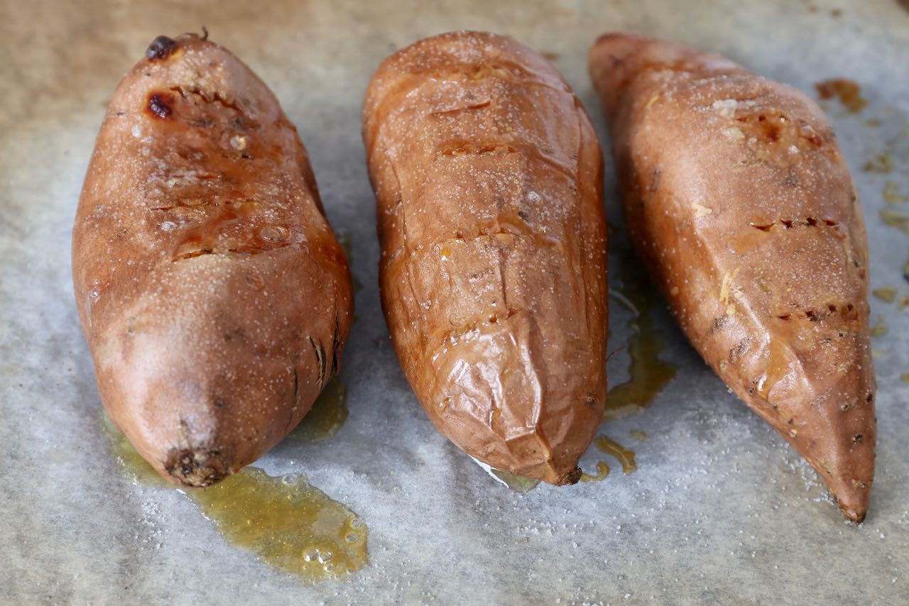 Bake Sweet Potatoes in the oven for 50 minutes until skin shrivels.