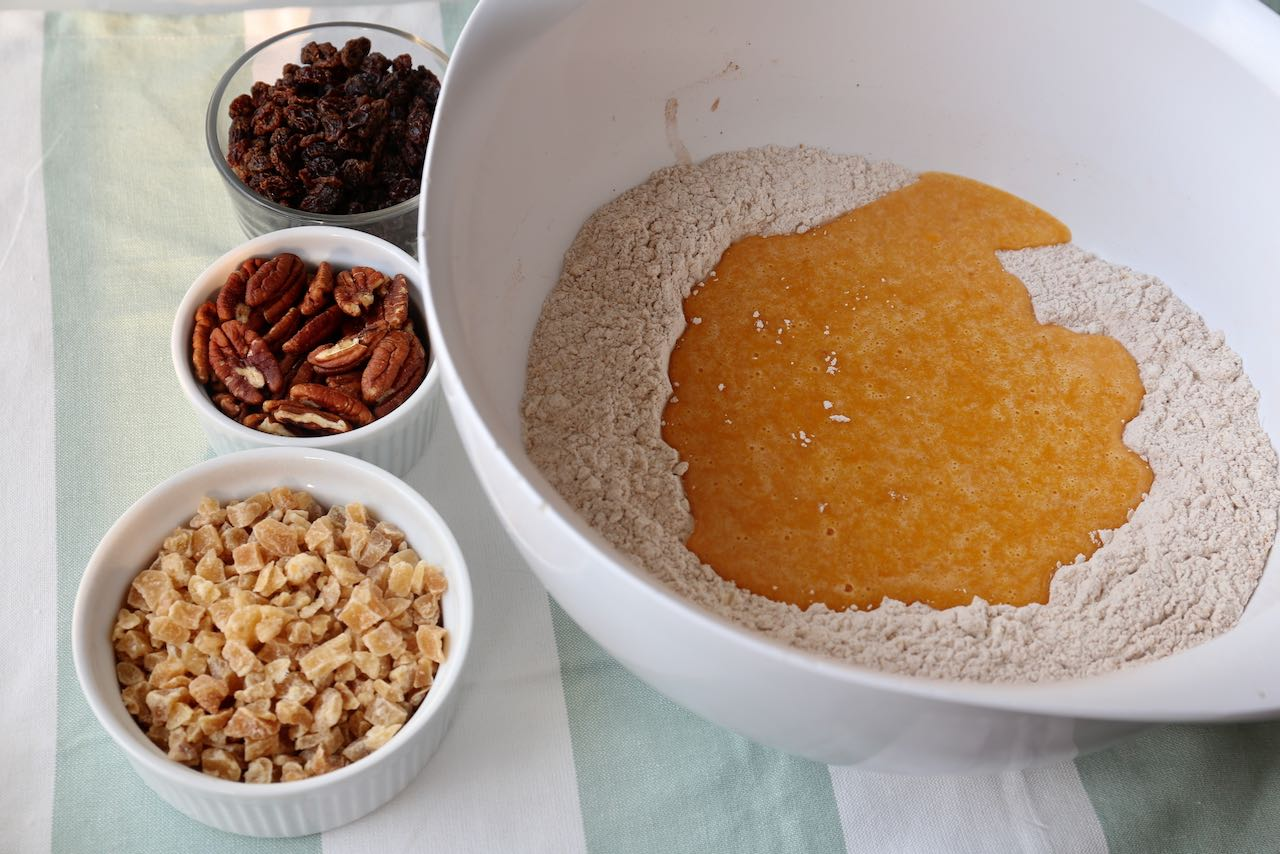 Pour sweet potato batter into dry ingredient well and mix with raisins.