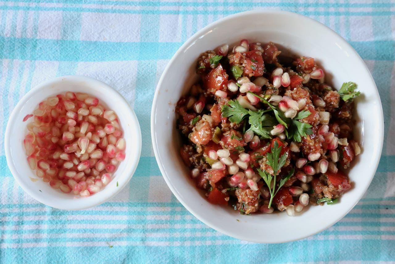 Pomegranate seeds offer a pleasant crunch to Kisir Bulgur Salad.