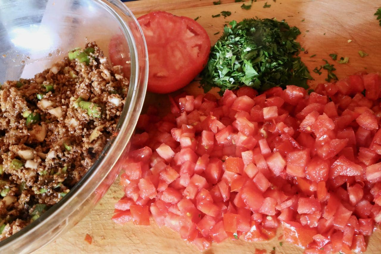 Best Kisir Recipe: Add chopped tomatoes and parsley.