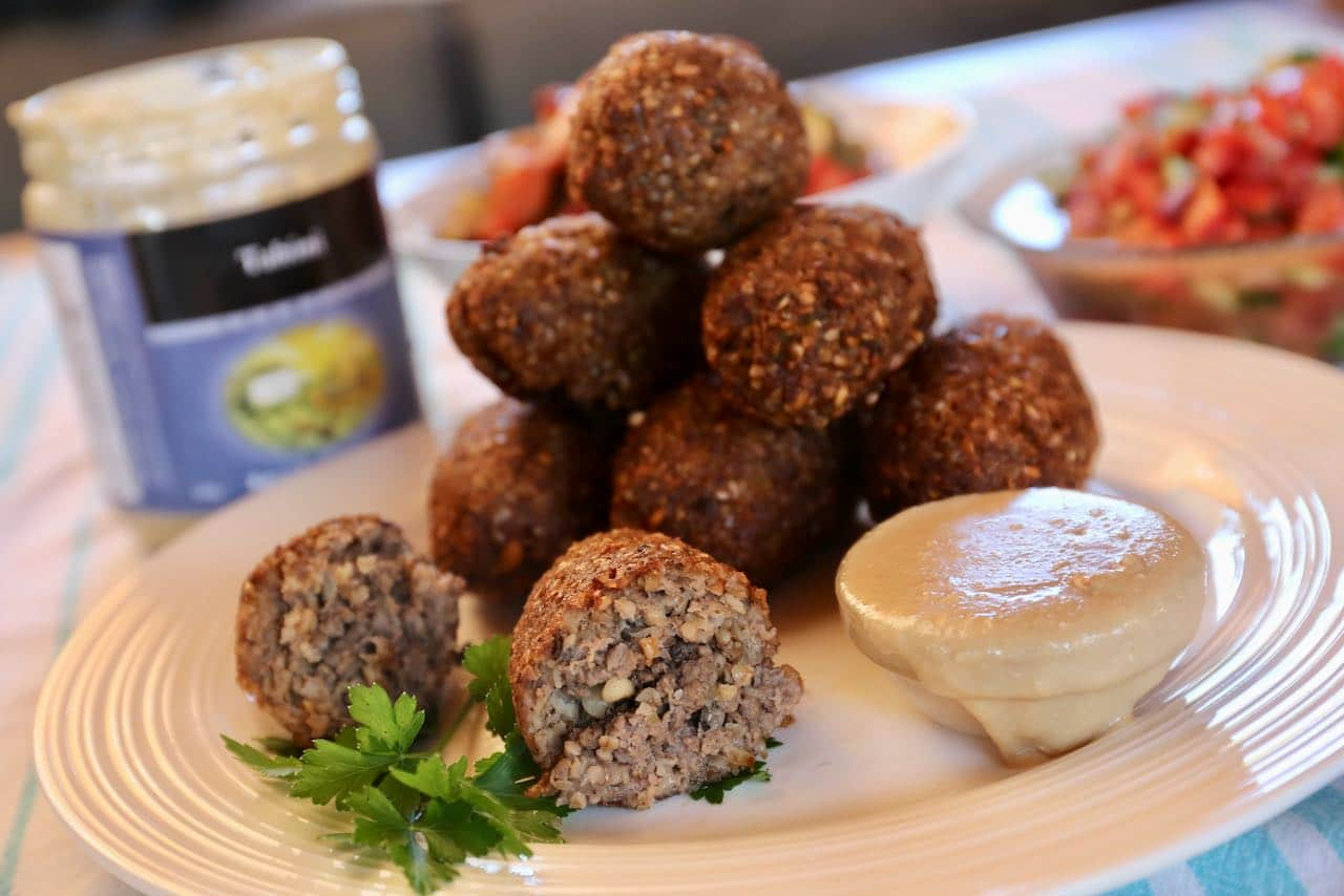 Slice fried kibbeh in half and you'll find a spiced pine nut interior.