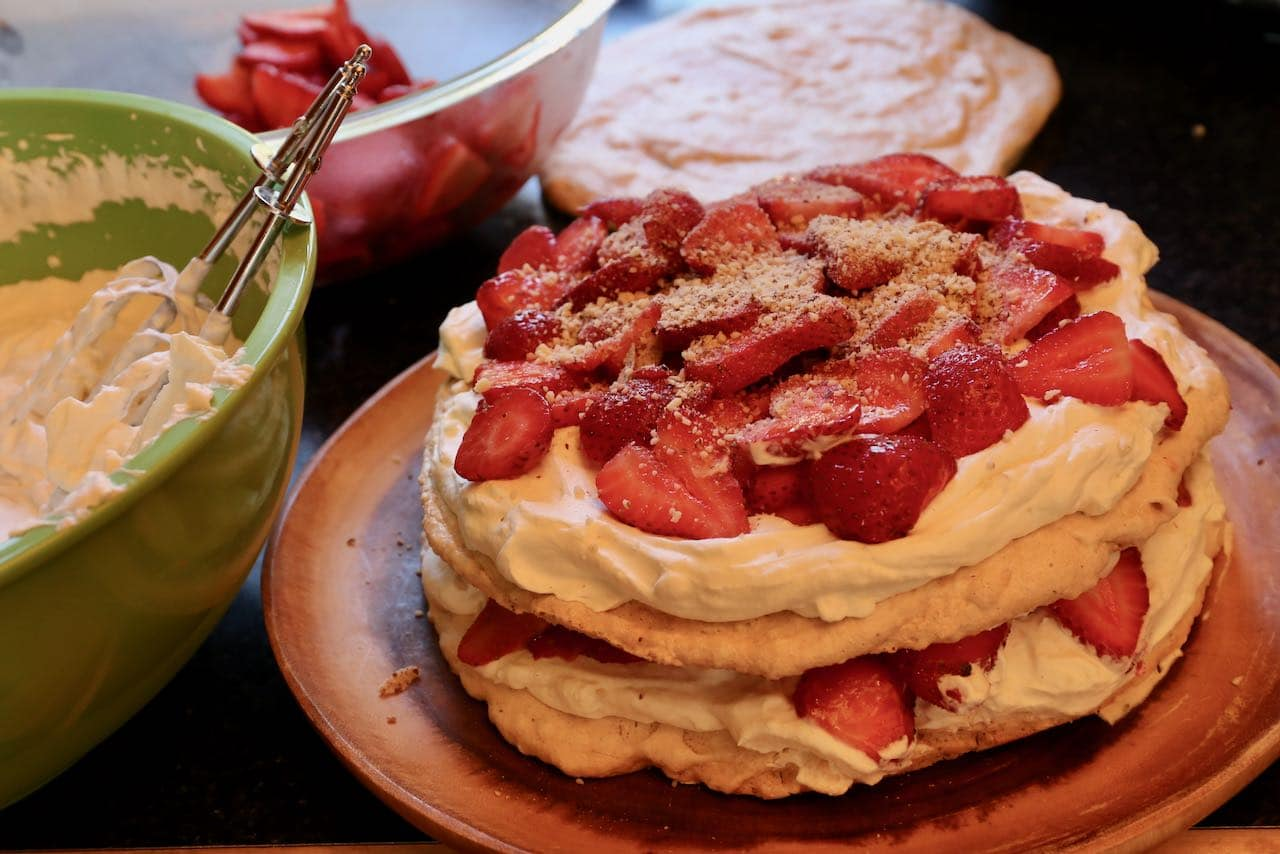 Sprinkle ground almonds on Swedish Strawberry Midsommar Cake.