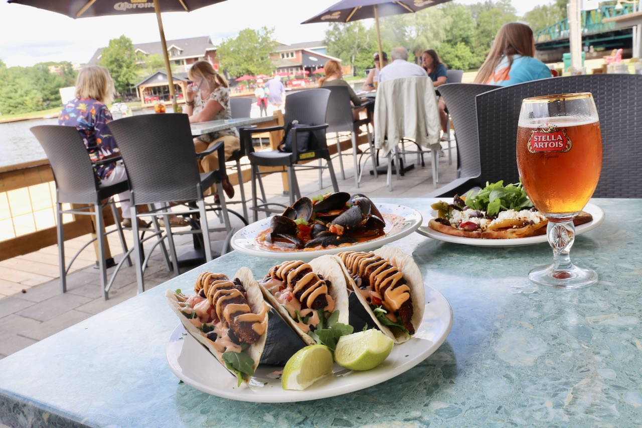 On The Docks Pub offers the best patio with a river view in Huntsville.