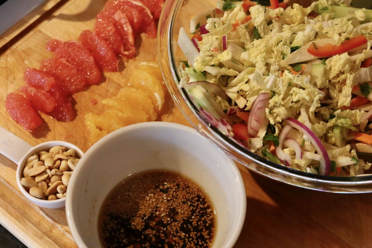Toss Singapore Salad with dressing and top with grapefruit, orange and peanuts.