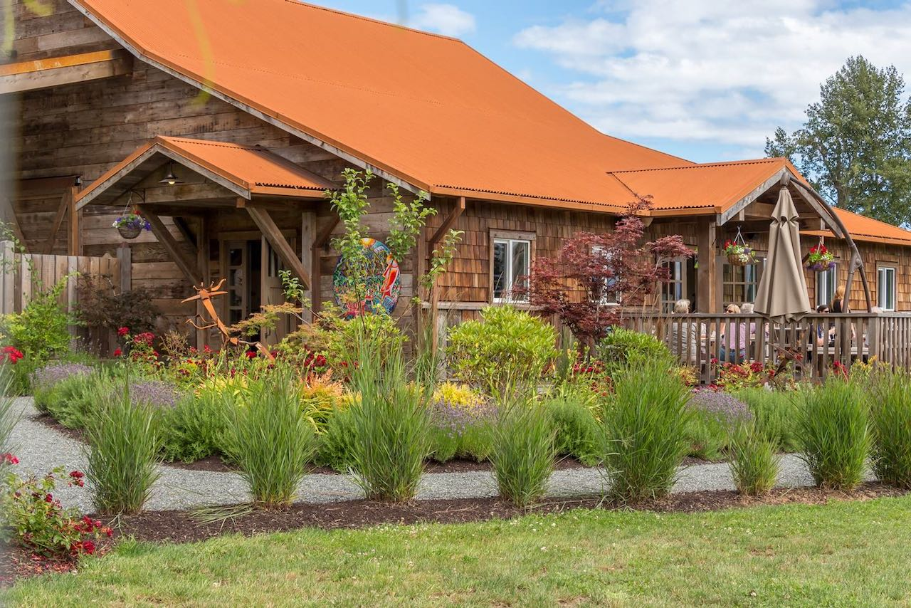 Wineries on Vancouver Island: Beautiful garden and outdoor patio at Beaufort Vineyard.