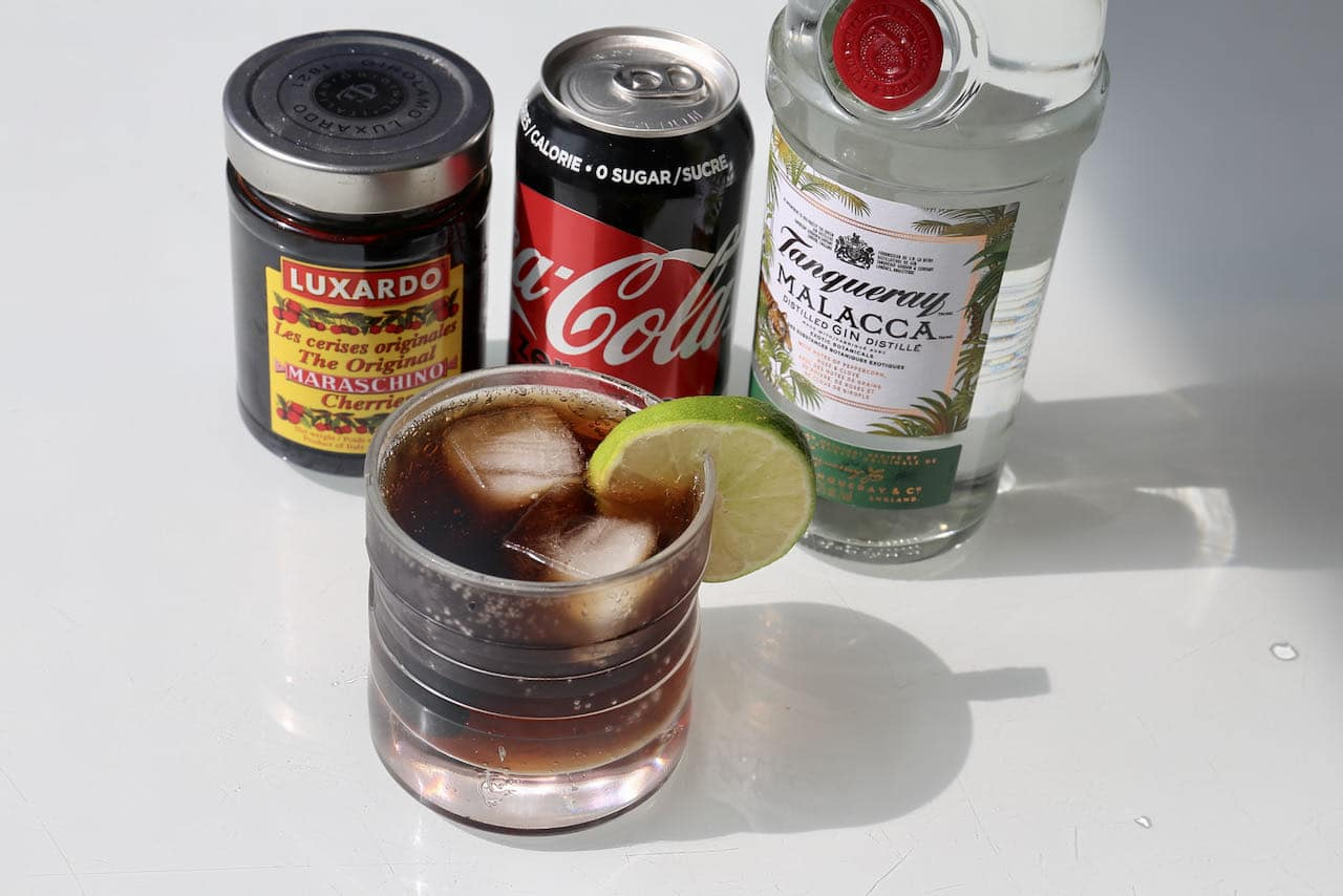Muddle Coca Cola with premium gin and top with lime and Luxardo cherry.