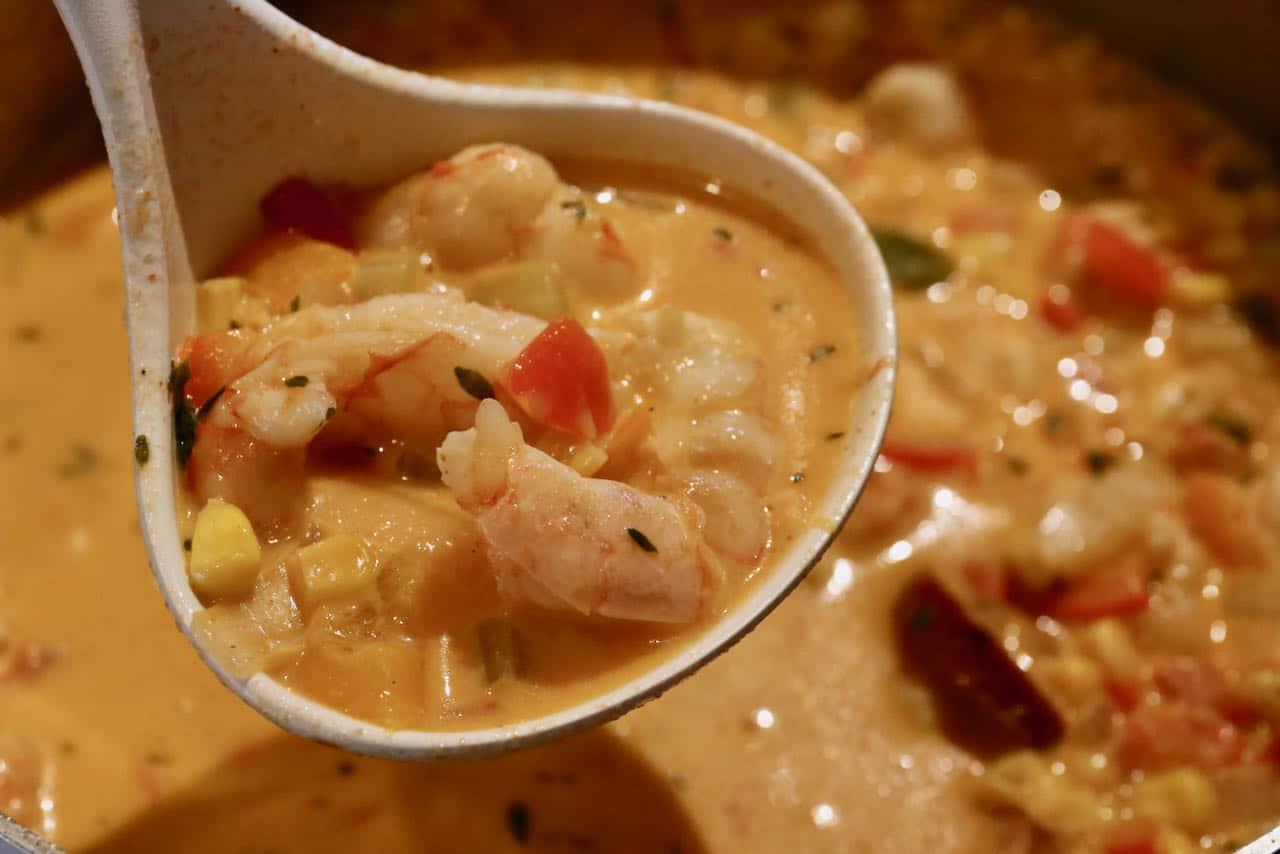 Use a ladle to serve homemade Cream of Shrimp Soup.