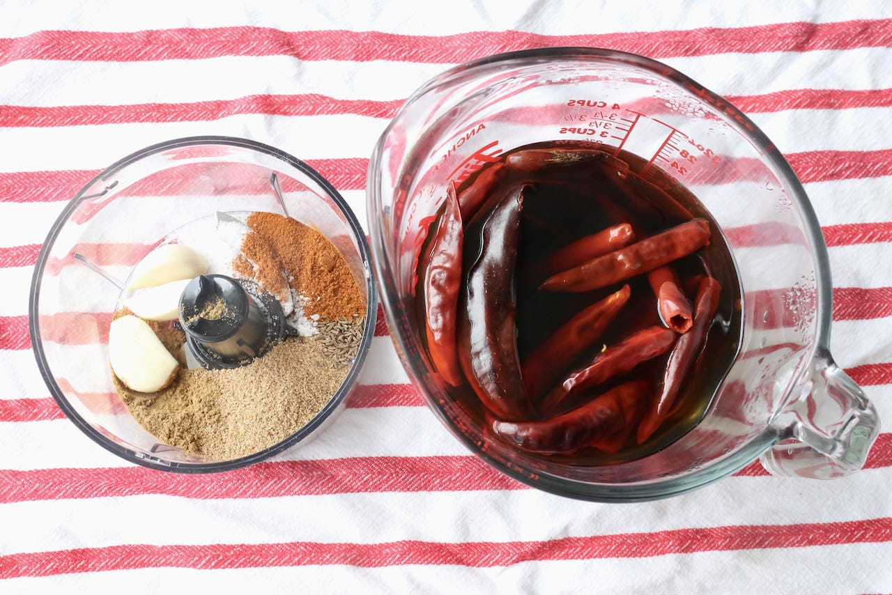 Soak dried chilies in warm water and blend spices and garlic in a food processor.