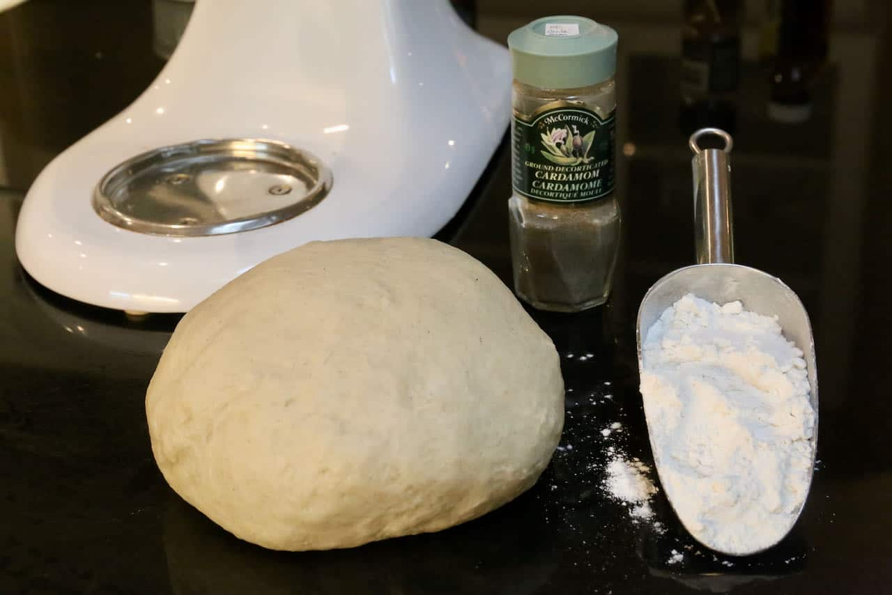 Roll Kardemummabullar dough into a ball and let rest white dusting counter with flour.