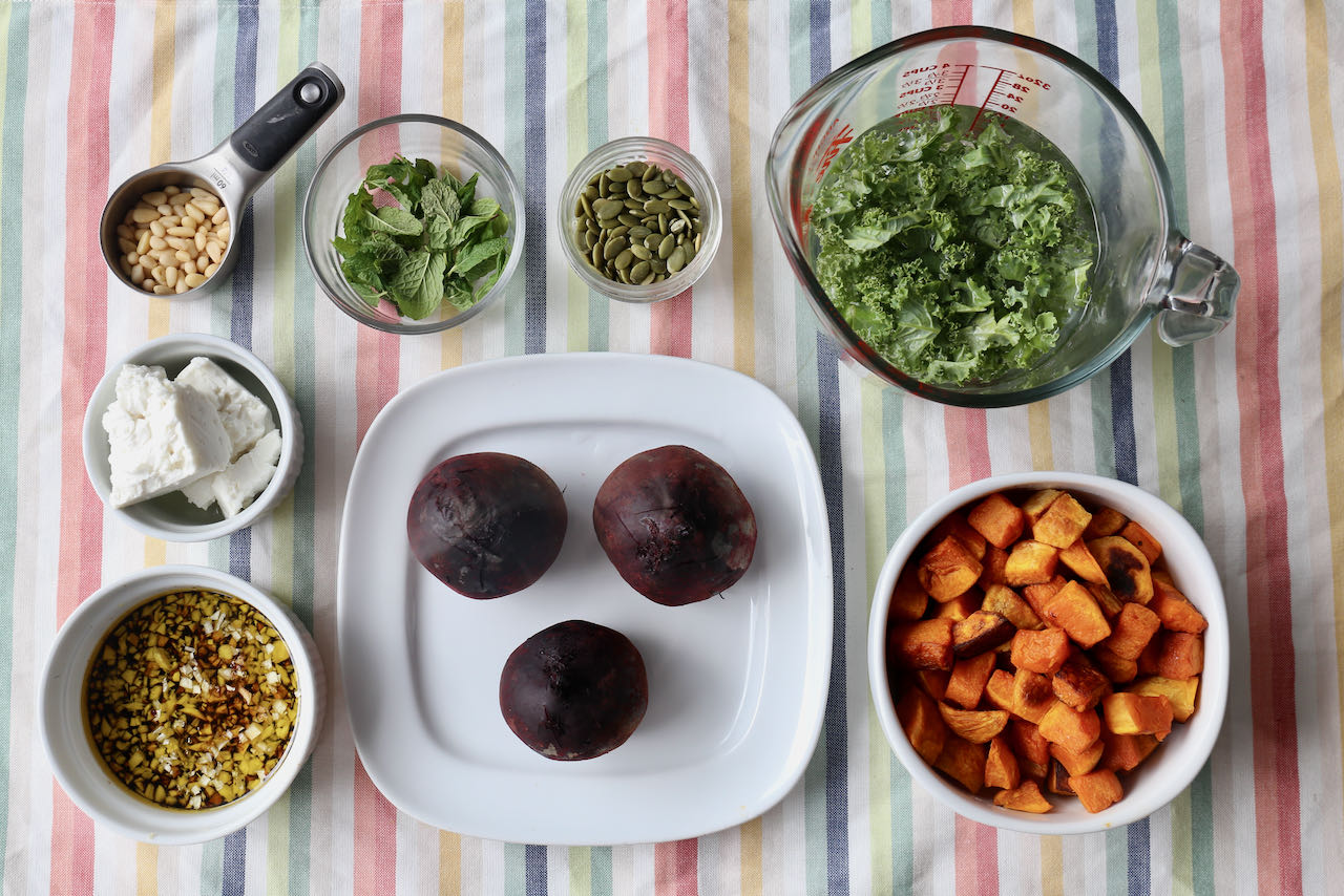 Before assembling your pumpkin and beetroot salad chop kale and whisk together the vinaigrette.