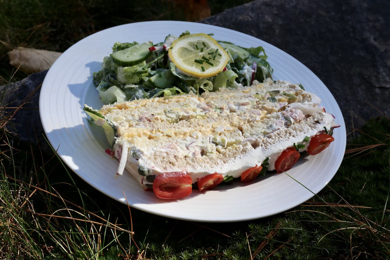Slice Swedish Sandwich Cake and serve with a fresh salad.