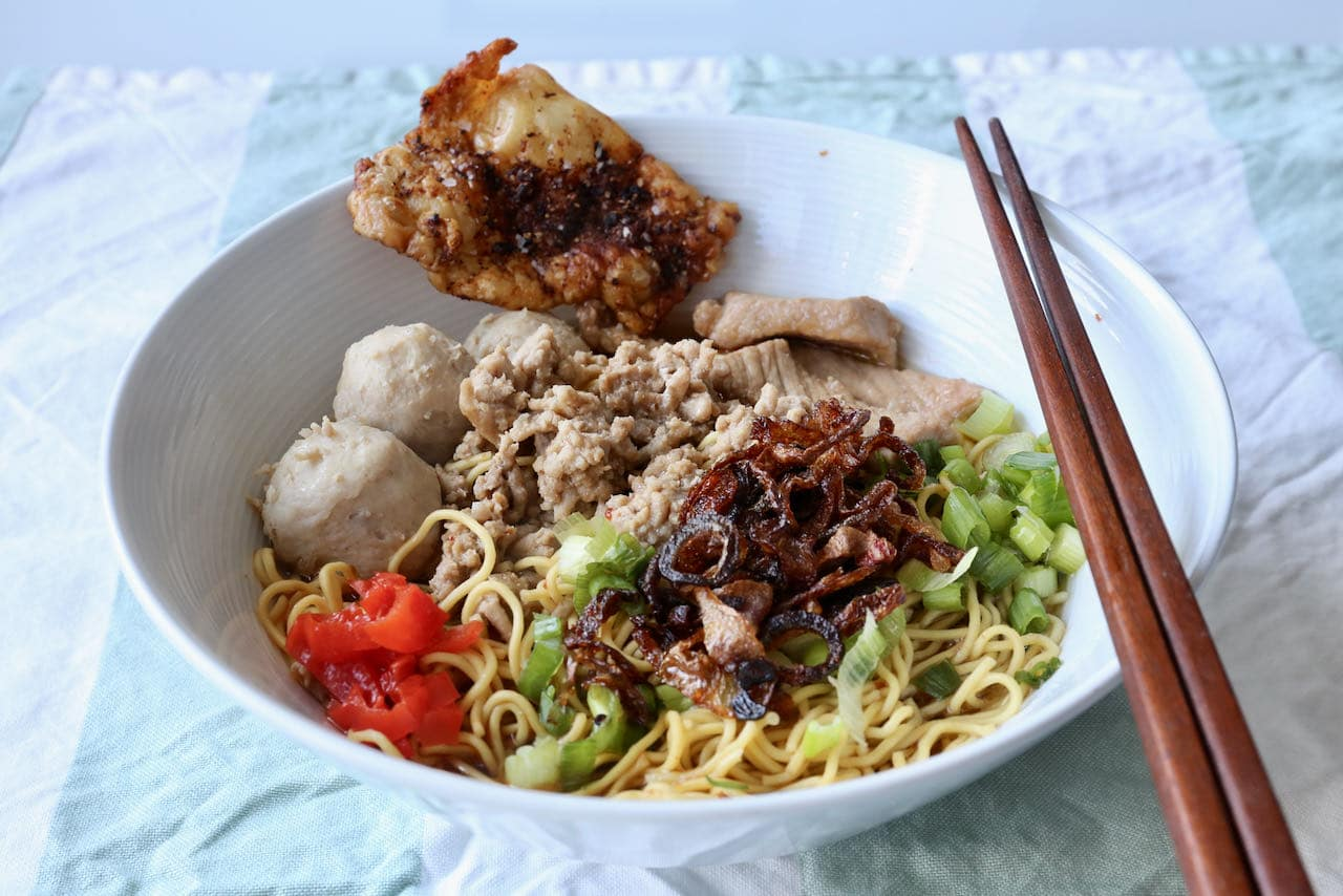 Serve Bak Chor Mee with chopsticks and a spoon so you can easily grab noodles and slurp the soup broth.