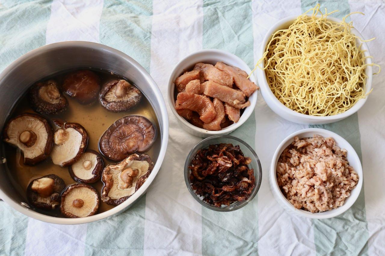 Begin preparing Bak Chor Mee by soaking dried mushrooms, frying shallots and marinating pork.