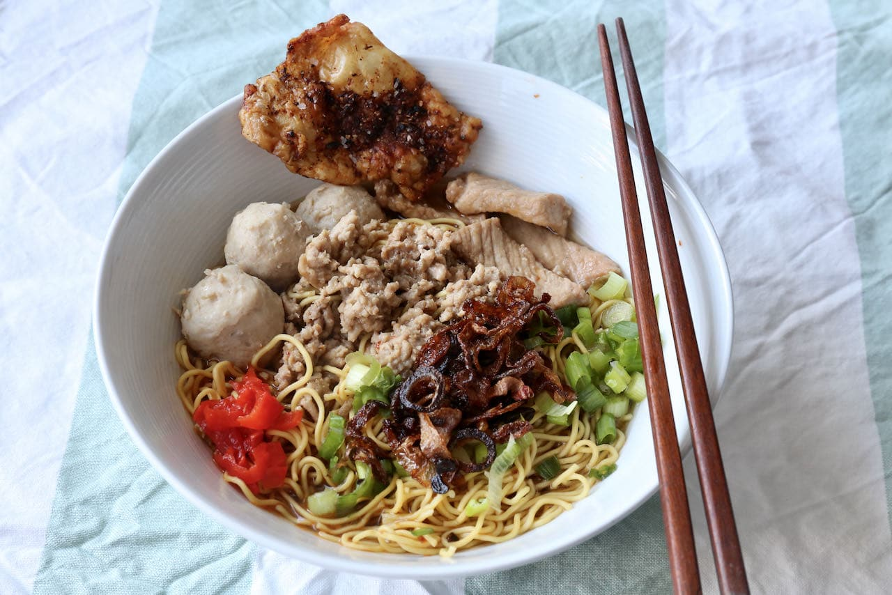 Garnish Singaporean Bak Chor Mee noodle soup with fried shallots, spicy red chili, scallions and chicken cracklings.