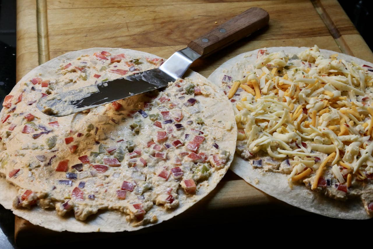 Slather tortilla with Antojito filling and sprinkle with shredded cheese.