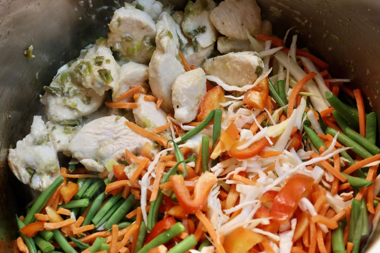 Add sliced cabbage, green beans and bell peppers to the Chicken Manchow Soup.