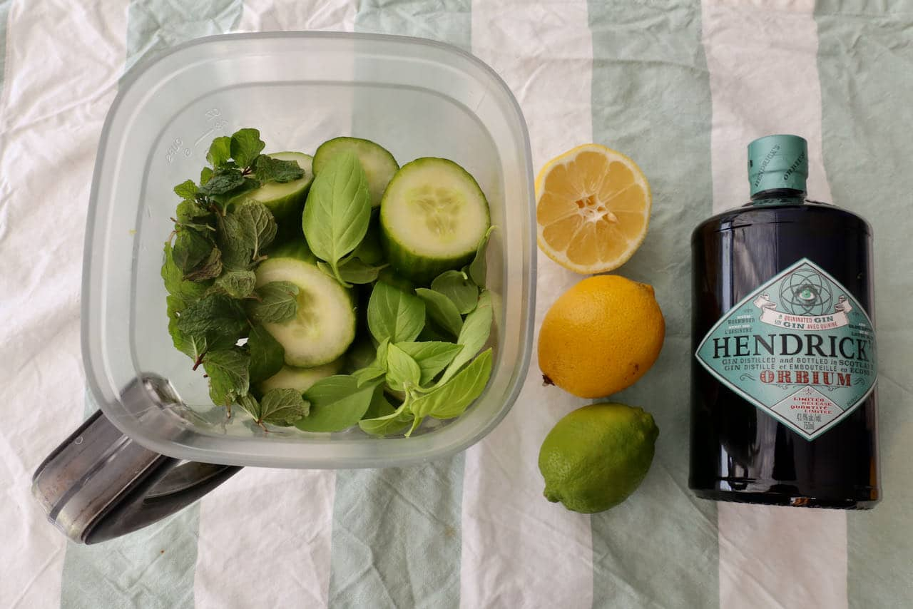 Add chopped cucumber and fresh mint and basil to a blender and blitz until smooth.