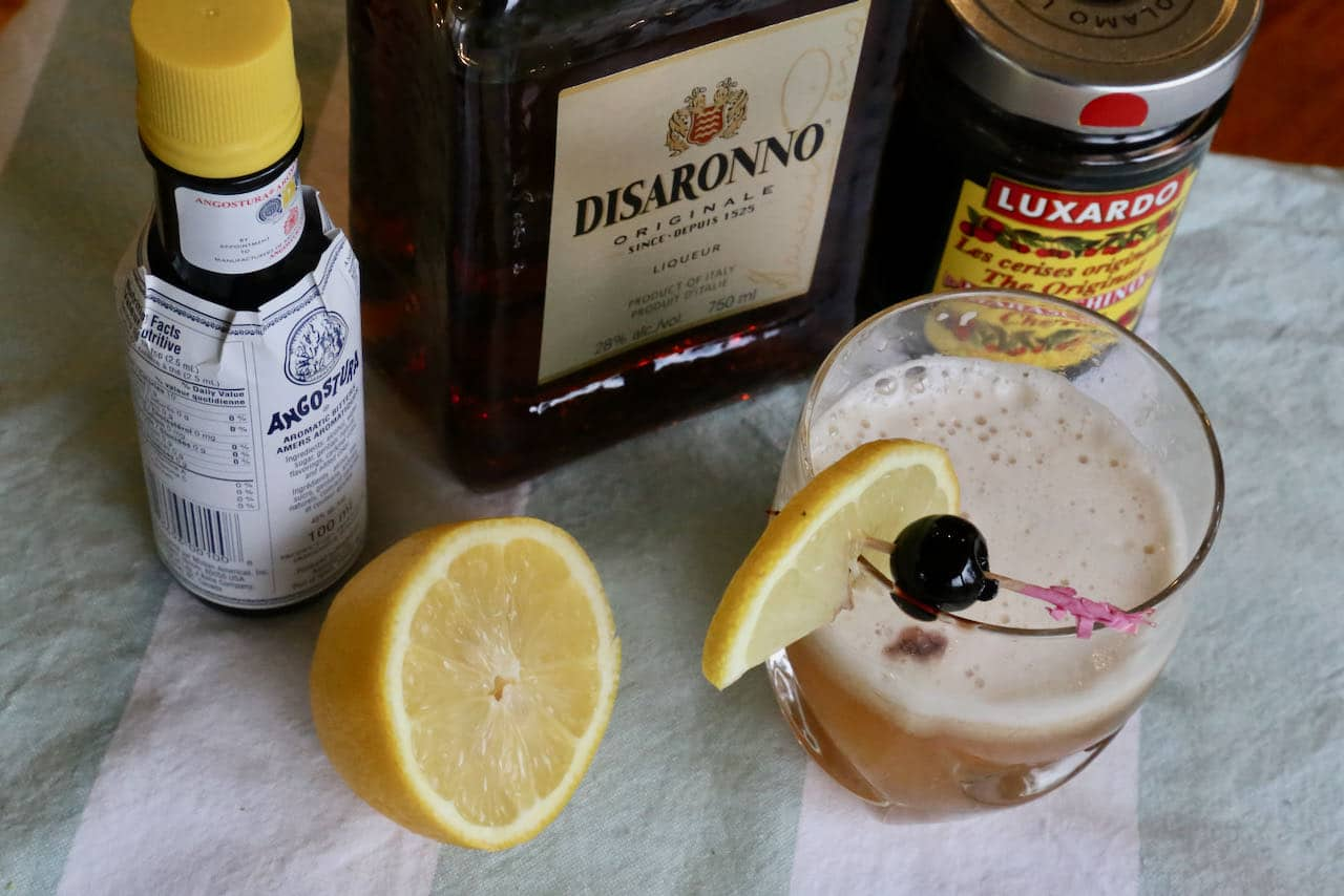 Garnish a classic Disaronno Sour with a lemon slice and Maraschino cherry.
