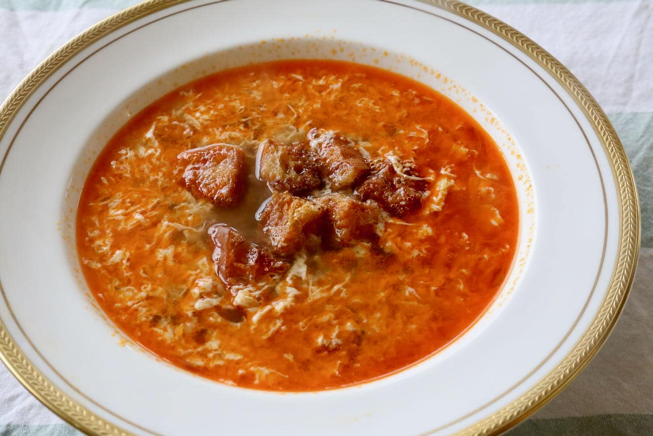 Sopa de Ajo is the ultimate Spanish soup recipe to prepare for pork and garlic lovers.