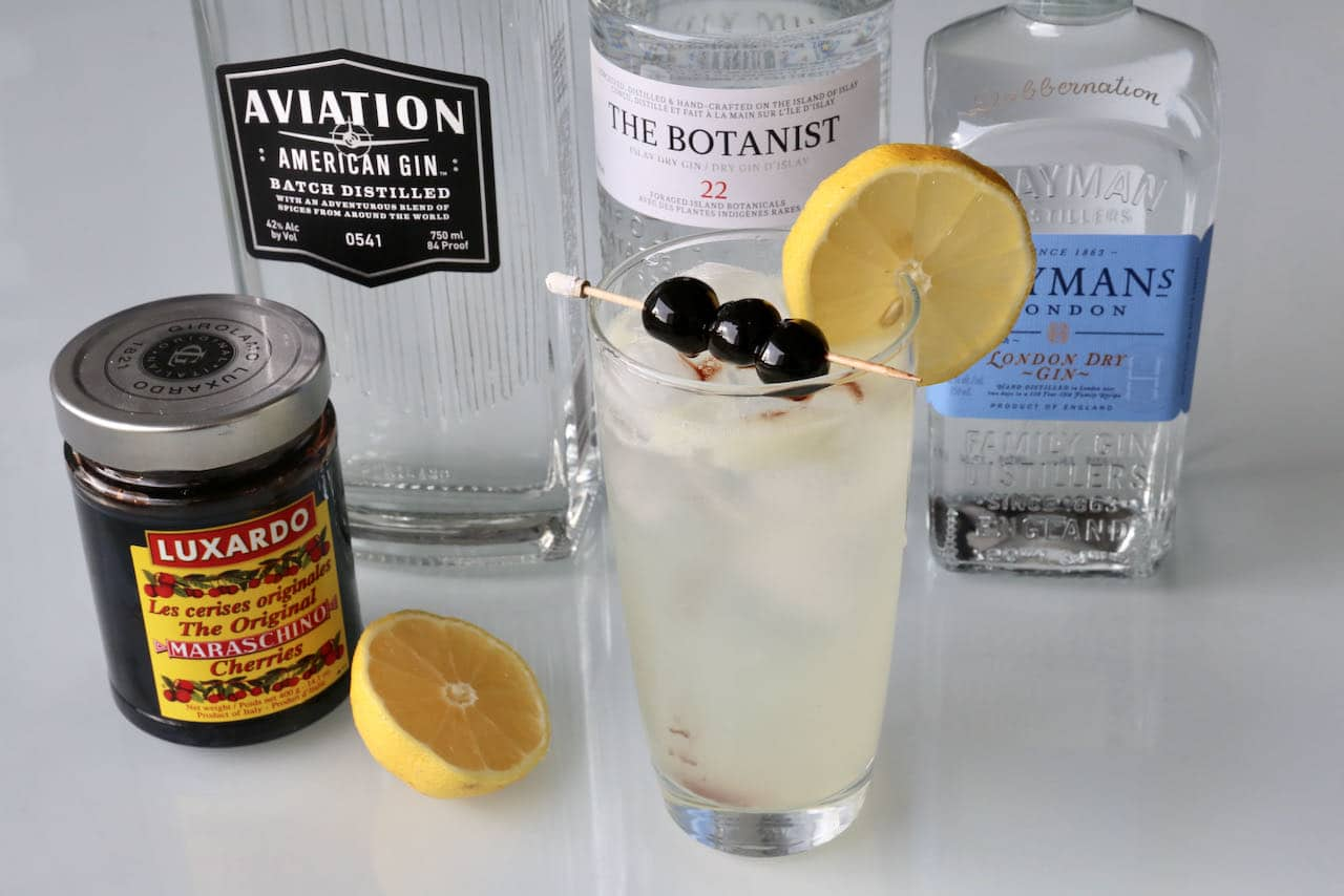 John Collins Drink ingredients include gin, lemon juice, simple syrup, soda and Maraschino Cherries.