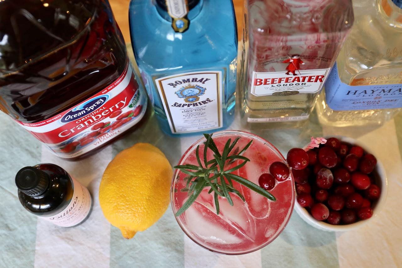 Our Gin and Cranberry Cocktail recipe is garnished with fresh cranberries and rosemary sprig.